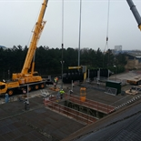 Two crane lift for replacement of the first refurbished screw pump